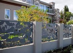 I absolutely love this decorative fence with the silhouettes of the flowers outside of this beautiful home. I've heard that having a fence like this can increase your property value by up to 5% sometimes! I'll have to keep this design in mind as my wife and I try to decide about getting a decorative gate put outside our home.