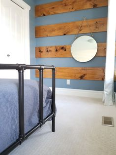 Amazing Rustic Farmhouse Wood Feature Wall in our shared boys bedroom.