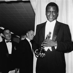 Sidney Poitier | Black Hollywood Series Sidney Poitier poses backstage at Academy Awards with his Oscar statuette for Best Actor in a Leading Role for his performance in the film 'Lilies of the Field,' 1964.