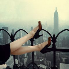 Woman wearing pale beige nylons by Gotham and two-color pump by Mademoiselle, November 1950, Manhattan, New York City, photo by Edward Kasper