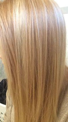Light strawberry blonde hair with platinum highlights