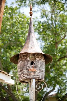 Birdhouse~old barrel w Edison megaphone top on old porch post
