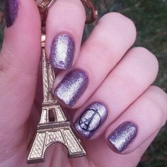 Show your support for Paris with thoughtful nail art.
