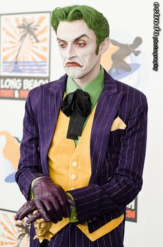 The Joker. I have to say I love his face, that is some awesome makeup...but also...just his face! ~ S