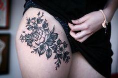 floral thigh tattoo
