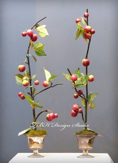 Christmas crab apples in footed mercury glass vases