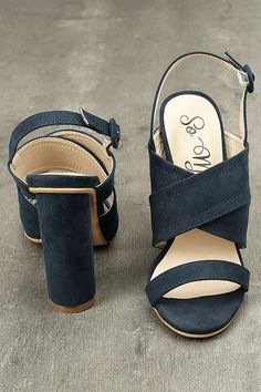 Take the Abiona Navy Suede High Heel Sandals on all of your evening adventures! Soft vegan suede straps create a caged, peep-toe upper with adjustable ankle strap (and covered buckle).