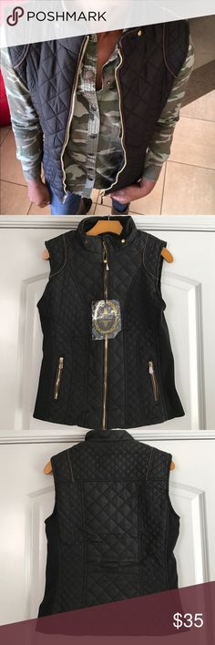 Quilted Light Weight Puff Vest Black quilted puff vest with brown piping and gold zip. Two front pockets. Elastic side panels. Faux fur inside. Very warm and on trend. Jackets & Coats Vests