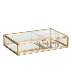 Rectangular jewelry box in clear glass with a metal frame and a mirrored glass at base. Lid with small hook at front and metal chain at one