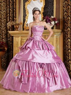 Romantic Lavender Sweet 16 Dress Strapless Taffeta Beading Ball Gown  http://www.fashionos.com  http://www.youtube.com/user/fashionoscom?feature=mhee   A gorgeous party dress for the woman who wants to sparkle and delight at special occasion party. This strapless sweetheart lavender quinceanera dress features a ruched bodice and the neckline is emphasized by a lot of beadings.