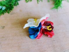 Rockabilly hair flower clip, floral hair accessory, summer hairpiece, July 4th headpiece. July 4th is coming up soon! Complete your outfit with this patriotic hair flower clip with red, white and blue tropical flowers! Handmade