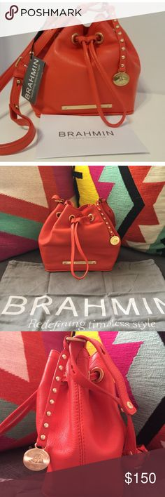 """NWT! Brahmin Lexie Drawstring Crossbody NWT! Brahmin Lexie Drawstring Crossbody Tango Orange Nepal color. Cute little bag that holds more than expected. Drawstring front closure. Hanging detailed Brahmin medallion...Adjustable strap can be worn shoulder or cross body.  Make an Offer!!!  Interior zip pocket, key clip and 1 slip pocket.  Brahmin lining. 25"""" adjustable strap. 7 L x 4 W x 7 H Brahmin Bags Crossbody Bags"""