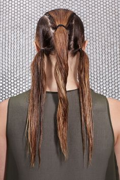 Smooth styling cream through the hair and use a comb to divide it into three clean sections from the hairline to the neck. Brush each section back into a low, tight ponytail, positioning the center ponytail slightly above the other two, and secure each with small, black elastic. That's it, style over. (Just kidding.) #refinery29 http://www.refinery29.com/how-to-style-wet-hair#slide-14