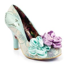<p>Sophisticated and sassy with a hint of Dynasty glam, you will look like the ultimate diva in this aqua take on an IC classic. Enrobed in a fabric floral upper with a slash of faux snakeskin detailing and finished off with two large silky flowers.</p> <ul> <li>High heel</li> <li>Flower embellishments</li> <li>multi faceted upper</li> </ul>