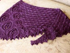 The entire time I was working on the Seven Sonnets I had Edgar Allan Poe in the back of my mind. He has always been one of my favorites and when I got my hands on the rich dark purple from Shalimar Yarns I immediately thought of bird wings. Raven wings.