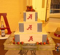 Alabama Grooms Cake - Peanut butter cake iced in peanut butter buttercream.  Cake is accented with chocolate Alabama A's,  houndstooth edible image paper and chocolate dipped strawberries.