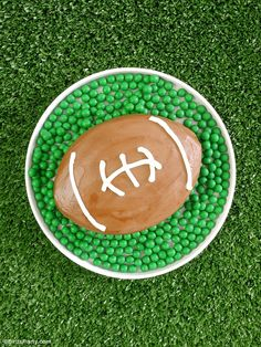 American Football Surprise Cake - super easy to make WITHOUT any special cake pans, and tastes delicious! Ideal for a Super Bowl birthday party or NFL game watching or tailgating celebrations! - BirdsParty.com @birdsparty