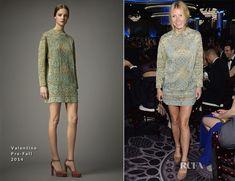 A Valentino shapeless aqua-and-gold brocade dress, and Valentino suede platform ankle-strap pumps.