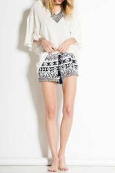 Soft tribal knit shorts with drawstring waist, fringe detailing with tassel. Subtle pop of pink coloring throughout waistband and fringe on the legs.   Tribal Knit Shorts by easel. Clothing - Shorts Dallas, Texas