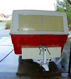 Bright red 1974 Hunter Compact II camper front.
