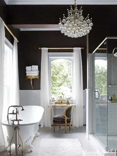 The master bath's chocolaty walls play up the brilliant whites of a recycled tub, curtains in Kally Almost White sheer.