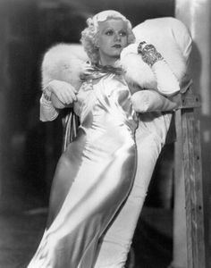 Beauty from the 1930s--Jean Harlow, the original platinum blonde. Beauty designed to light up the silver screen, best seen in black and white photography. Note the emphasis on white--furs, gloves, dress--all to emphasize her hair. Also note the bias cut dress worn with no underwear.