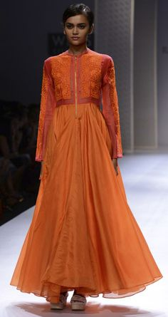Orange silk long dress by RAHUL MISHRA. http://www.perniaspopupshop.com/wills-fashion-week/rahul-mishra #fashionweek #willslifestyleindiafashionweek