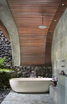 Bathroom: Awesome Modern Outdoor Bathroom With Oval Bathtub And Natural Rock Wall Design Natural Stone Flooring With Wooden Ceiling: Extraordinary Outdoor Bathroom Design