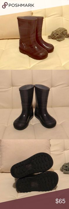 Burberry Rain Boots EUC Rubber rain boots with nova check pattern. Very small indentations on the top of each boot. See photo. This flaw is not noticeable—I am just discovering it. Very clean inside and out. Recently polished and weather-proofed. Made in Italy. Size 6/7 Burberry Shoes Rain & Snow Boots