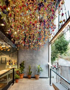 known for eclectic restaurant designs spanish firm marked the entrance of barcelona eatery bellavista del garden del norte with thousands of hanging