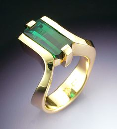 18k gold woman's ring with green Tourmaline. $3,380.00, via Etsy.