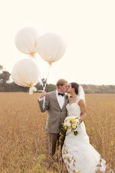 The newlyweds pose with geronimo balloons.   | Photo: Karena Dixon Photography