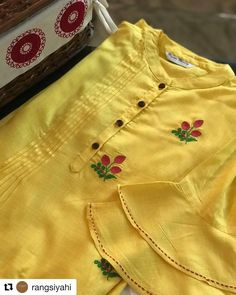 "Available via RangSiyahi ""SOLD OUT ""The pretty lemon has delicate strawberry buds embroidered. It is further embellished with fine pintucks… Embroidery On Kurtis, Kurti Embroidery Design, Embroidery Fashion, Embroidery Dress, Dress Neck Designs, Sleeve Designs, Blouse Designs, Kurti Sleeves Design, Kurta Neck Design"