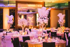 Feather and floral wedding table centrepiece // Vincent and Sarah's Glamorous White Wedding at Mandarin Oriental