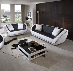 Diese exklusive Polstergarnitur überzeugt durch modernes Design. Die Sitzfläche und Rückenlehne der Garnitur sind mit schwarzem Lederimitat bezogen, die Armlehnen und der Korpus mit weißem Lederimitat.