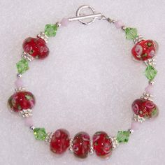 """Rose Garden"" handmade beaded bracelets created with Swarovski ""Peridot"" & ""Pink Alabaster"" crystals, red floral lampwork glass beads, sterling silver bali spacers, sterling silver beads and finished with a sterling silve toggle clasp."