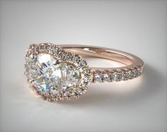 Three Stone Engagement Setting in Rose Gold - Ring price excludes center diamond.