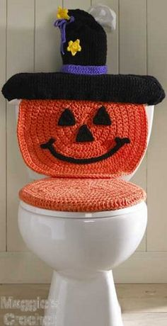 Crochet toilet seat cover...maybe this would remind the boys to put the seat down...gotta see the pumpkin's face!