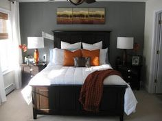 Gray bedroom with dark furniture. Great room for combining him and her :)