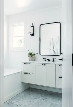 08 white Scandinavian bathroom with marble surfaces - DigsDigs
