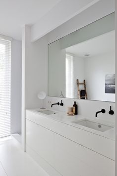 simple vanity. only need one basin. Large mirror, interesting line to ceiling near mirror