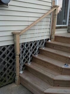 Use rope & boat dock ties on your step handrails for a nautical look!