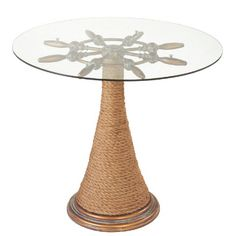 The perfect ship's decor accent table that add that nautical look with it's ship's wheel design.