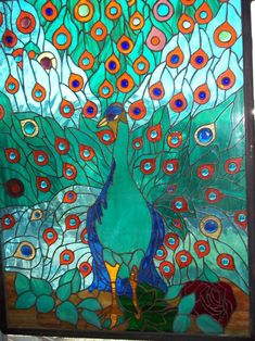 peacock - this my own adaptation of a tiffany window it is 27.5x36 can be installed inside or out it is encased in double pan glass with steel frame