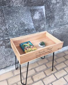 Upcycled wine crate coffee table with hairpin legs and openable Perspex top.