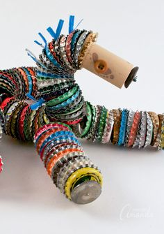 Who knew that bottle caps could be transformed into a rag doll bottle cap horse!