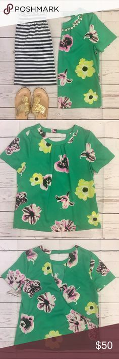 • J. Crew •• Blouse • J. Crew Swoop top in Punk Floral, size small. A must have, blogger favorite, for your closet. Great condition. J. Crew Tops Blouses