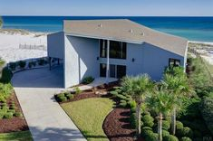 Ideal for entertaining, this gorgeous contemporary home sits on its on stretch of beach.