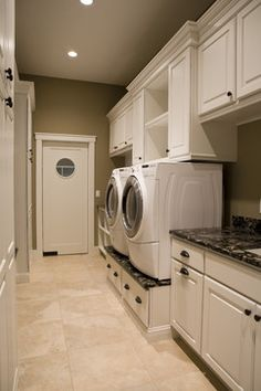 A porthole window adds a creative touch to this Madison style door and connects visually to the round doors on the washer + dryer.