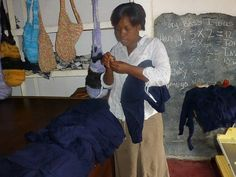 Learning to make school uniforms with the new knitting machine in Zambia.